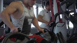 Two young guys in the gym