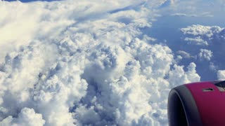 View from airplane on blue sky and clouds