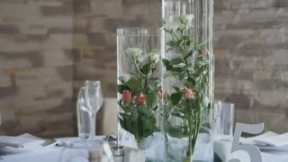 Waitress put wineglass at wedding table in a restaurant