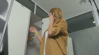 Woman changes clothes in the dressing room in the sport center