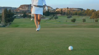 Woman comes to golf ball for final blow