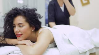 Woman enjoy the procedure of lifting skin in beauty clinic