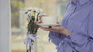 Woman enjoys coffee break