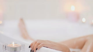 Woman enjoys the relaxation in the bath