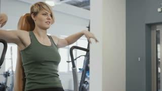 Woman finish train on the training apparatus