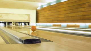 Woman hand throws bowling ball