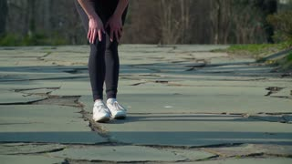 Woman has a pain in her leg during running