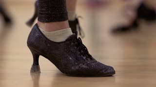 Woman in dancing shoes makes the movement of the floor
