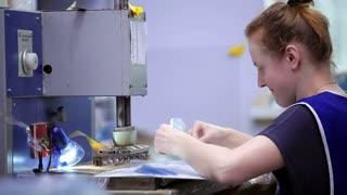 Woman manufactures plastic envelopes