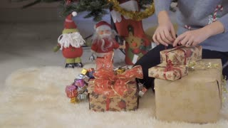 Woman packs christmas gifts