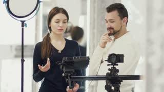 Woman-producer explain operator the frame setting