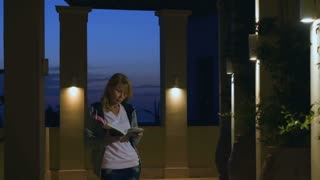 Woman read the journal standing in luxury villa