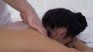 Woman relax during neck massage
