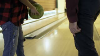 Woman throws bowling ball
