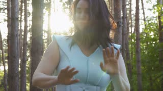 Woman wave off from insects in the forest