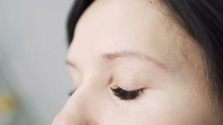 Woman with false eyelashes