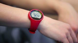 Wrist digital watch on the woman's hand