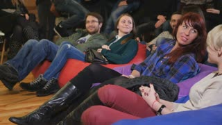 Young audience laughing on a comic show