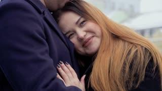 Young beautiful fat woman hugs with her man
