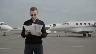 Young businessman is annoyed with an error in the documents in airport