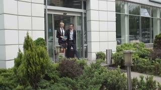 Young businessman leaves the car showroom