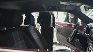 Young businesswoman test the car in the cabin