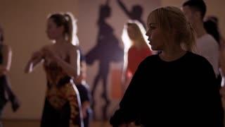 Young caucasian people are dancing in studio