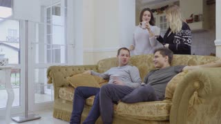 Young caucasian people communicates with each other at home