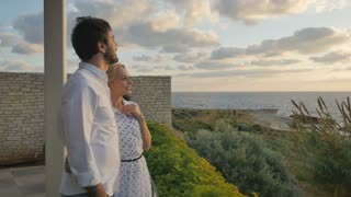 Young couple enjoys the view of the ocean