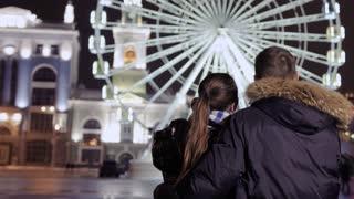 Young couple enjoys view on beautiful ferris wheel