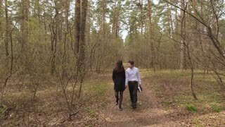 Young couple in love walking in the forest