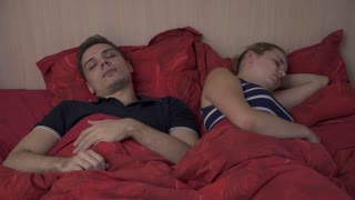 Young couple in the morning in bed in the bedroom