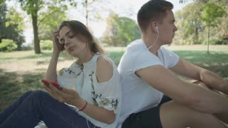 Young couple listening to music outdoor