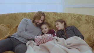 Young father read the fairytale to his little daughters