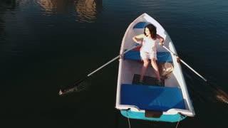 Young girl boating on the lake