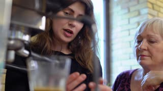 Young girl explain granny how to make coffee