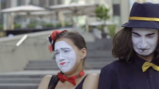Young girl mime pity her boyfriend