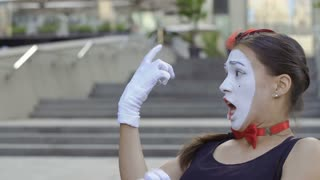 Young girl mime scary from her hand attack