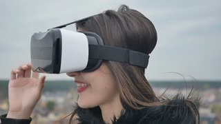 Young girl take off the virtual reality glasses