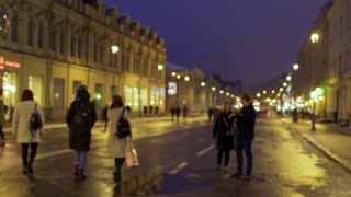 Young in love couple walks on the evening urban street