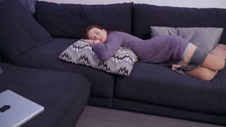 Young irritated woman relax on sofa at home after hard work day