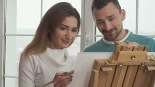 Young man and woman draws a picture