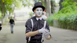 Young mime shows funny moves on the street