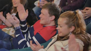 Young people applaud and laugh on comic show