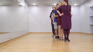 Young people are dancing in light studio