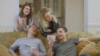 Young people drinks coffee at home and communicates with each other