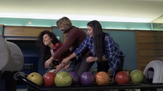 Young people fights for the bowling balls