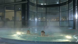 Young people relax in swimming pool