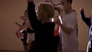 Young stylish people are dancing in the studio