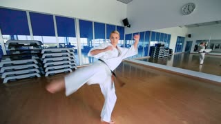 Young woman practicing the karate in the sport's gym